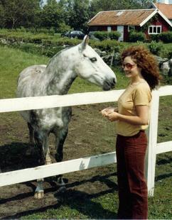 Dr. Kim greeting horses